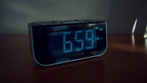 close up shot of alarm clock turns 7 AM