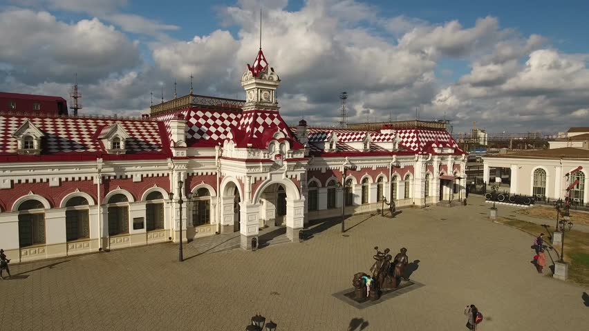 Old railway station Yekaterinburg Russia. Trans siberian railway. Aerial drone close forward flight to trains. Day sunny.