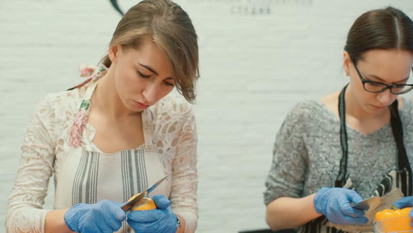 Pretty girl cleans the peel of lemon