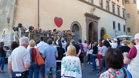 Nemi, Italy - June 2017: People attending music orchestra military performance at festival of strawberry