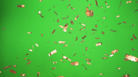 Real Confetti falling soft and beautiful in copper and with Green screen for party and celebrations like victories and birthdays or advertising