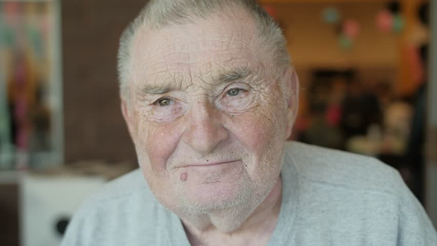 This short clip features an old, Caucasian man with a mole/wart below his lips. He flashes his thumbs up to the screen one after the other with a smile. Shot in real time. | Shutterstock HD Video #27494170
