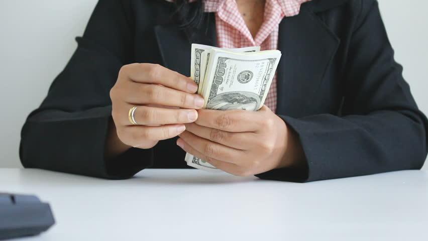 Close up shot hands of woman counting dollar bill banknote #27537790