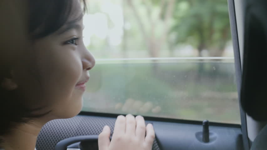 4K : Little girl looking from Window Car, Family Traveling on Countryside, Hand held shot | Shutterstock HD Video #27538360