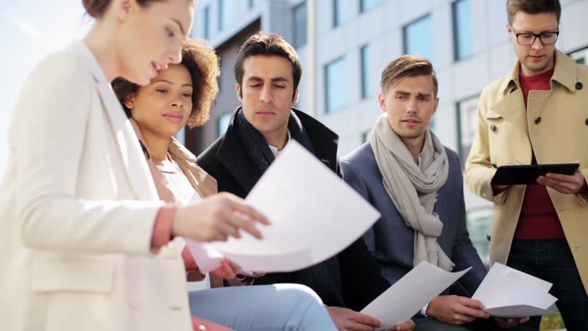 Business, education and corporate concept - international group of people with papers and tablet pc computer meeting outdoors | Shutterstock HD Video #27546289