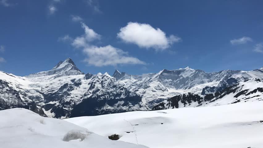 Time lapse of mountains around Grindelwald area, Wetterhorn, Schreckhorn.(Bernese Alps, Switzerland). On the way to Bachalpsee. Jungfraujoch, First station, Switzerland, Europe.