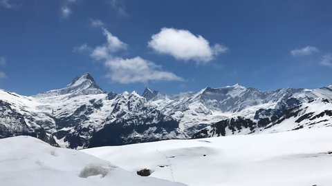 Time lapse of mountains around Grindelwald area, Wetterhorn, Schreckhorn.(Bernese Alps, Switzerland). On the way to Bachalpsee. Jungfraujoch, First station, Switzerland, Europe.