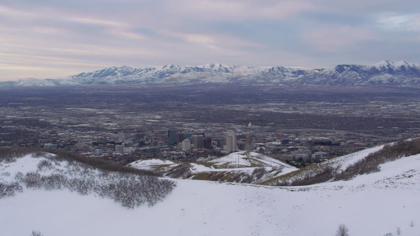 Salt Lake City, Utah circa-2017, Fly over snow covered hills to reveal Salt Lake City