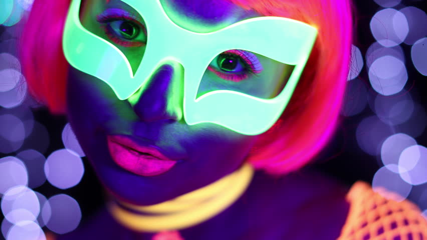 4k fantastic video of sexy cyber raver woman filmed in fluorescent clothing under UV black light