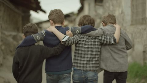 4K. Back view of a group of teen friends walking hugging each other. Vintage times. Childhood Memories. Shot on RED EPIC DRAGON Cinema Camera in slow motion.