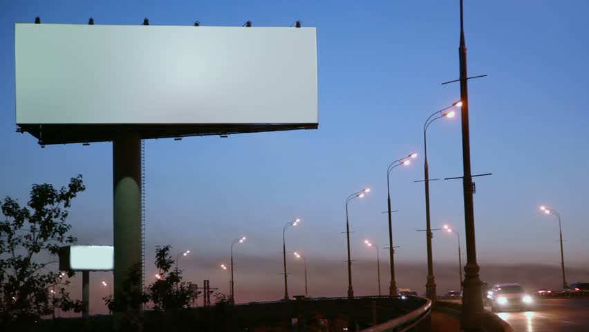Empty advertising billboard on sidelines of road with traffic at evening | Shutterstock HD Video #2761067