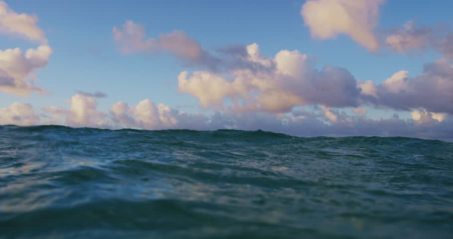 Over Underwater Surface with Dramatic Sunset Clouds. Beautiful Sunset Ocean Seascape.