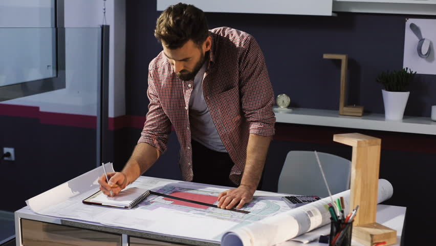 Young attractive bearded man architect working at a desk in the office | Shutterstock HD Video #27622090