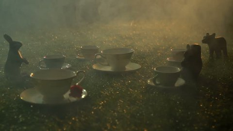 Fairy tea set on the grass in the smoke