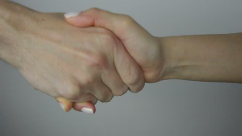 closeup of hand shake of nude man and woman on white background isolated