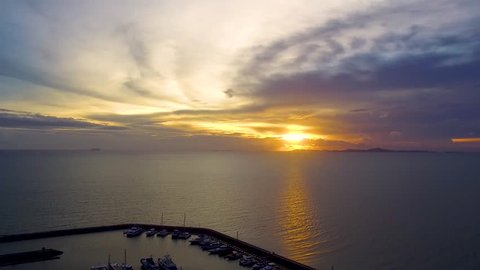Aerial shot  and yatch club with the sea sunset sky view