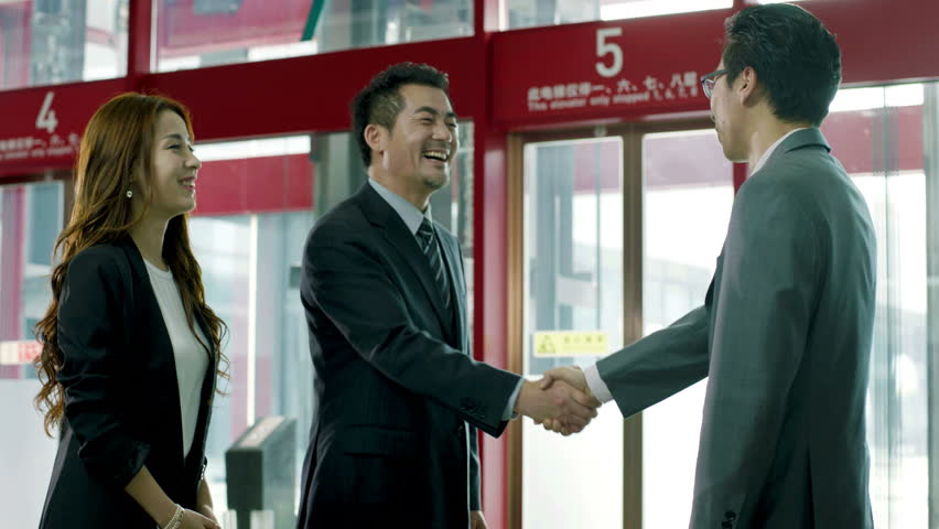 businessman meeting visiting client at elevator hall