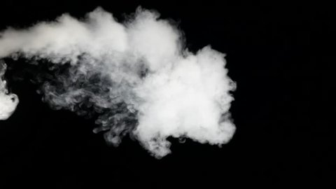 Smoke cloud over black background coming.