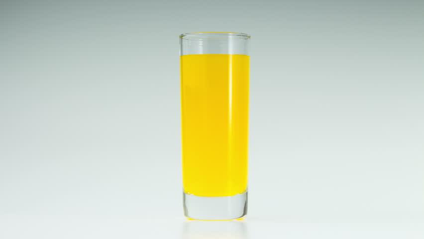 Orange juice in the glass on white background. | Shutterstock HD Video #27722890