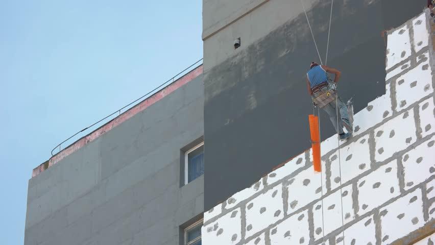 16082016 Odessa Ukraine Worker Insulating Building From