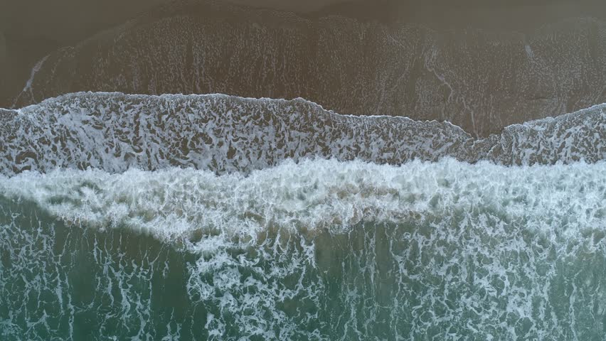 Aerial drone footage of ocean waves reaching shore. Beach on aerial drone top view. | Shutterstock HD Video #27740758