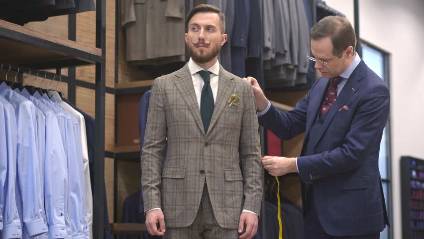 Tailor and customer in the atelier | Shutterstock HD Video #27814570