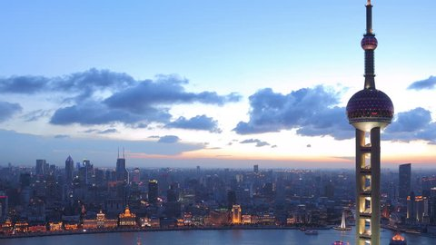 """SHANGHAI, CHINA - CIRCA JULY 2012: Panning time lapse of Shanghai skyline from day to night circa July 2012.  >>> Please search similar: """" ShanghaiSkyline """" ."""