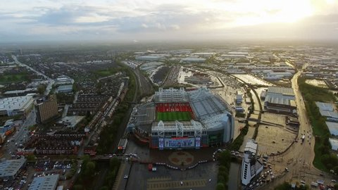 UK, MANCHESTER - APRIL 16, 2017: Old Trafford is a football stadium Greater Manchester, England, and the home of Manchester United. Aerial View Flying Over Iconic Football Ground in 4K Ultra HD