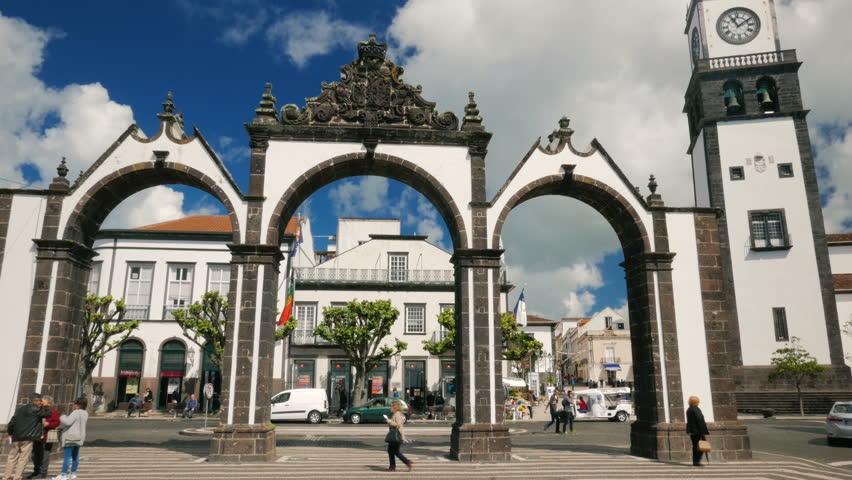 AZORES, May 2017 - POV gimbal shot of the Portas da Cidade - City Gates - in Ponta Delgada, Sao Miguel, The Azores, Portugal on a sunny day.