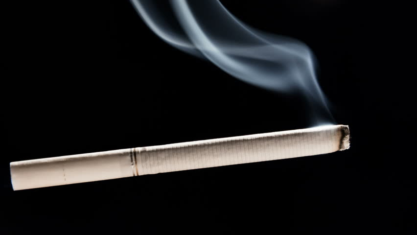 A Burning Cigarette In An Ashtray Black And White Stock