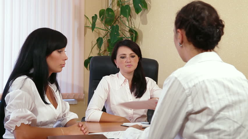 Three Young Women Discussing Business Issues in Office #2788810
