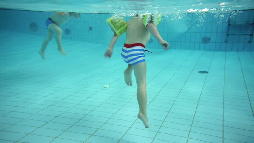 Kids Playing At A Swimming Pool Under Water View Stock Footage Video 2789077 Shutterstock
