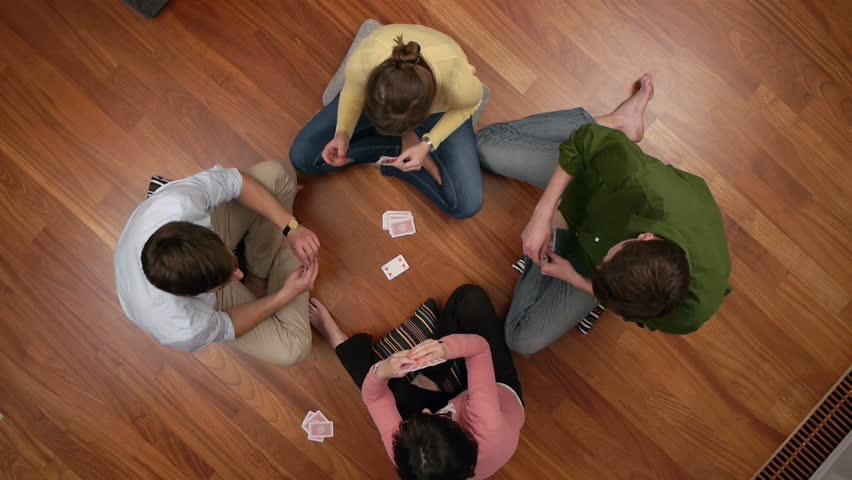 Friends plying cards overhead view  | Shutterstock HD Video #2789230