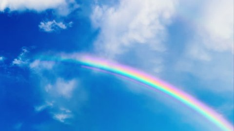 Rainbow revealed by clouds in sky time lapse
