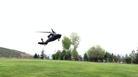 Military rescue helicopter landing at Aladaglar National Park in Nigde, Turkey.