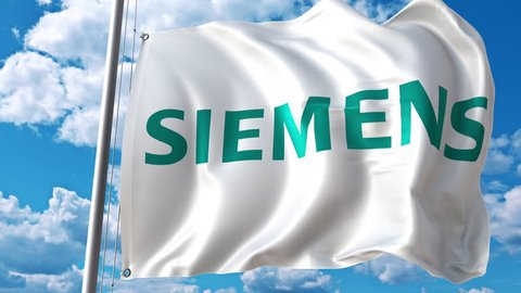 Waving flag with Siemens logo against moving clouds. 4K editorial animation