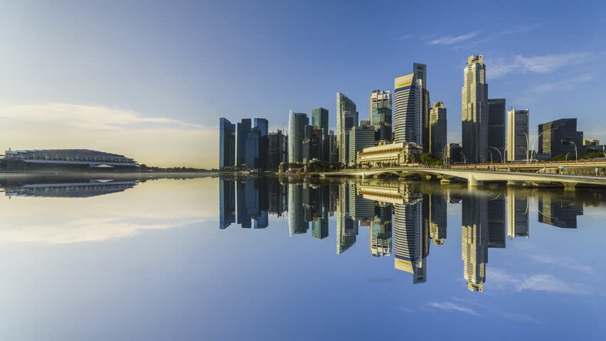 SINGAPORE, JANUARY 2017: City Skyline view across Marina Bay to the Financial and Business district of Singapore with clear blue sky. 4K. Motion Time lapse Zoom In.