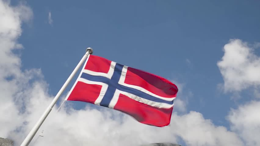 Flag of norway waving on a blue sky