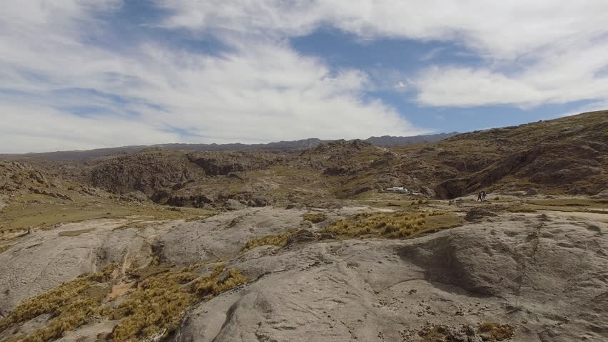 Aerial shot flying over rocky terrain near Mount Champaqui, Cordoba Province, Argentina | Shutterstock HD Video #27946942