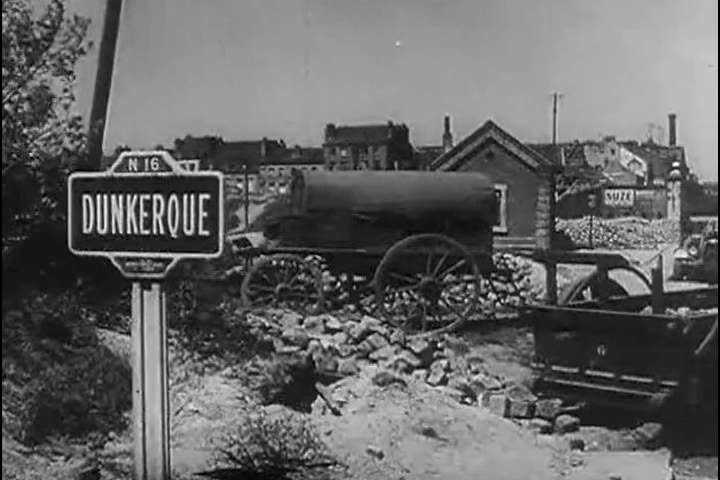 1940s: Footage of burning buildings among the wreckage in war-torn Dunkirk in 1940.