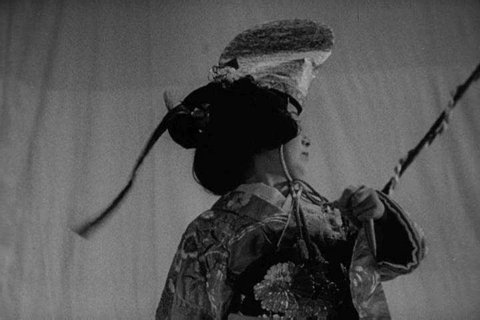 1950s: Sumi Yukawa, wife of Dr. Hideki Yukawa, performs a traditional Japanese dance, in 1954.