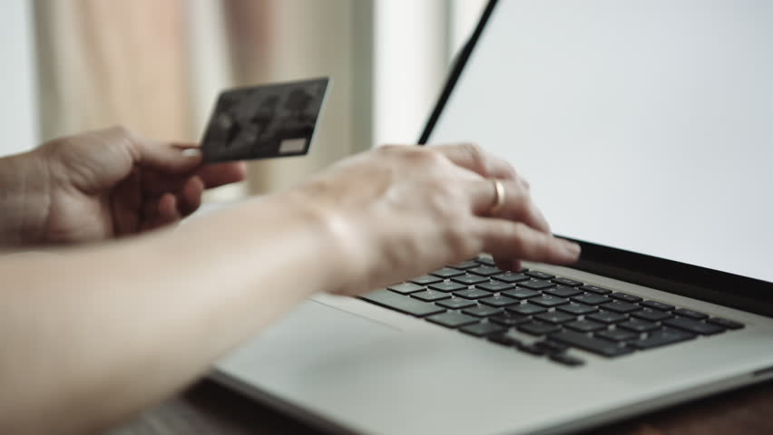 Close up shot of female doing online shopping with credit card | Shutterstock HD Video #28016110