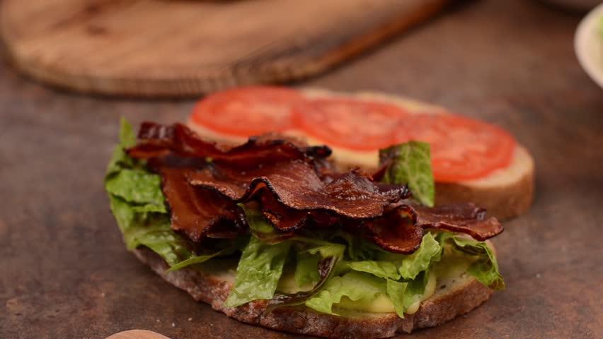 Finishing BLT sandwich | Shutterstock HD Video #28034500