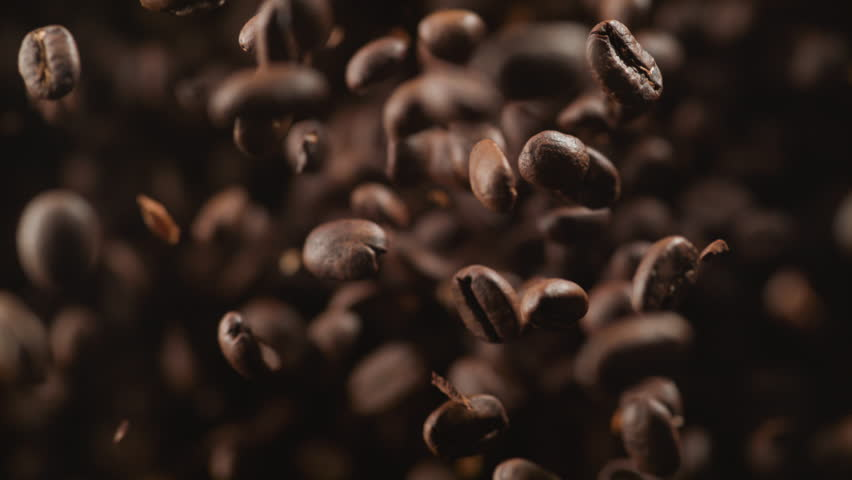 Coffee beans fly after being exploded. Shot with high speed camera, phantom flex 4K. Slow Motion.