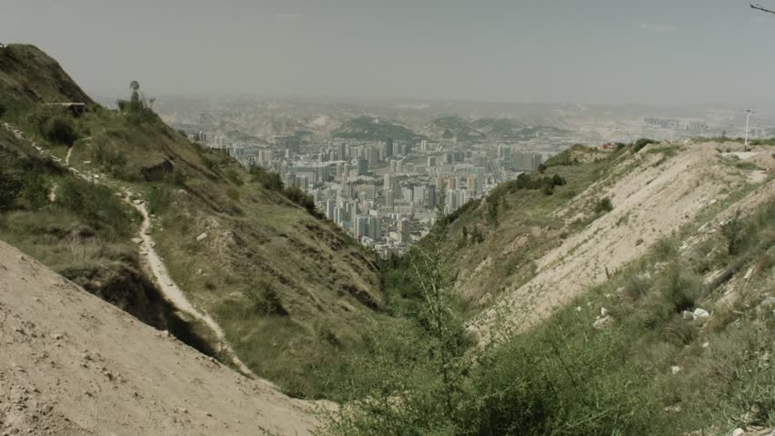A view over Lanzhou from the Lanshan Mountain. Wide shot.