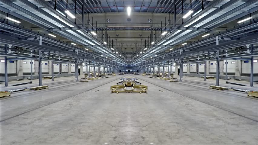 Electricians installing light in industry building, time lapse