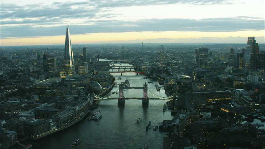 Aerial distant sunset view of the River Thames and city skyline of London UK RED DRAGON