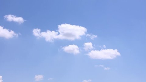 Seamless Loop Clouds, Time lapse clip of white fluffy clouds over blue sky, summer sky time lapse, sun shining and moving clouds, airplane passing by, Towering Cumulus Cloud Billows Time Lapse. FHD.