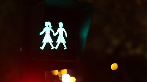 Crossing lights with mixed couple in Madrid, celebrating LGBT festival. World Pride Madrid 2017, Spain