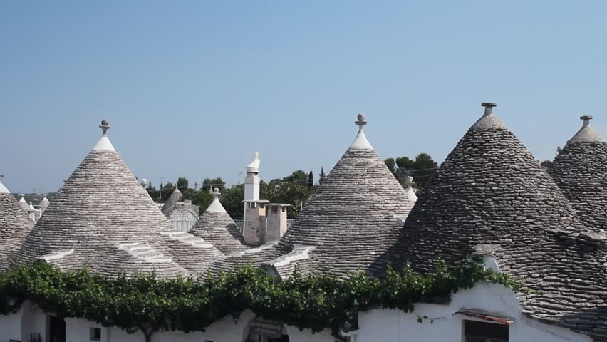View of Alberobello and the trulli, a traditional apulian dry stone hut,  typical a specific part of the south of Italy